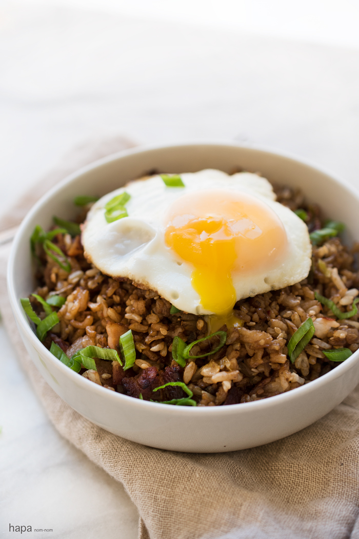 Try fried rice for breakfast with crispy bacon and toped with a fried egg. A hearty breakfast that's quick and easy!