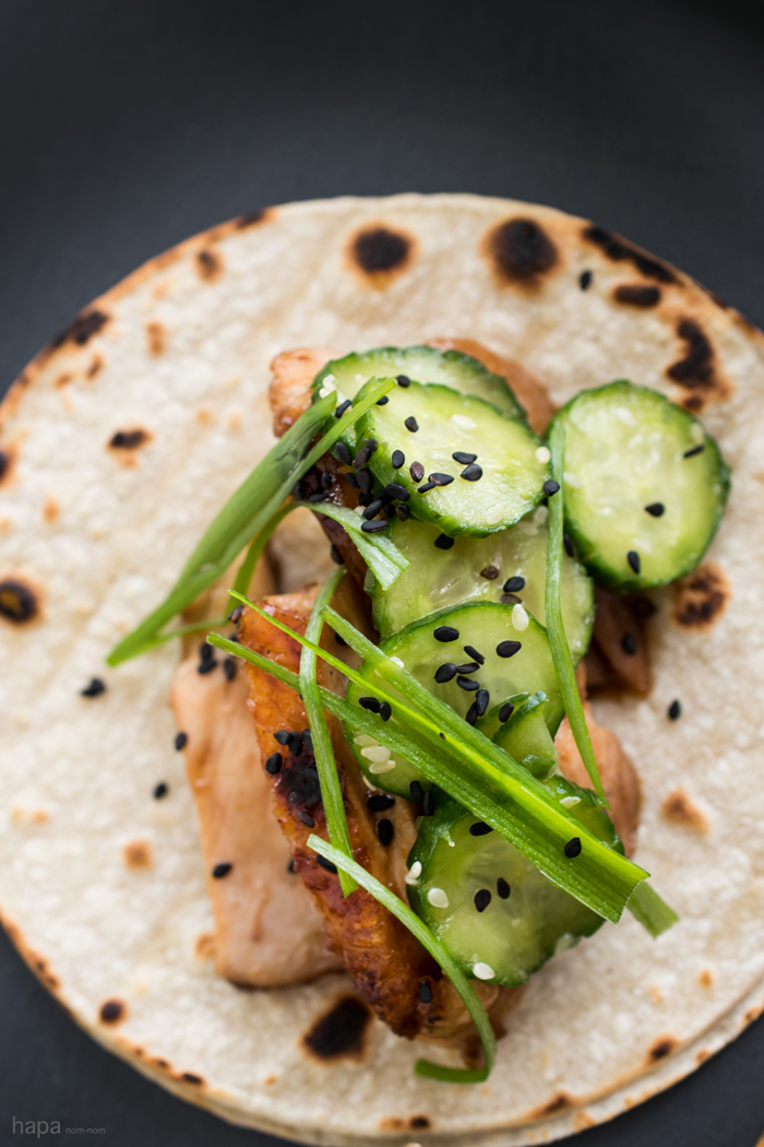Crispy Chicken Teriyaki Tacos with Japanese Cucumber Salad and a Spicy Sriracha-Sour Cream