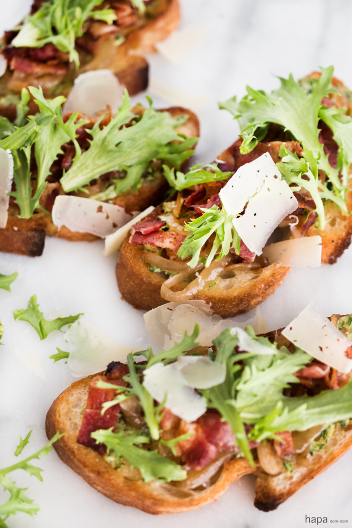 Caramelized Onion and Bacon Crostini with Green Herb Mayo, Frisée, and Parmesan