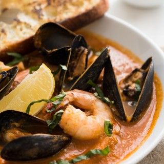Easy Bouillabaisse - Fresh fish, mussels, clams, and shrimp in a rich tomato-based broth