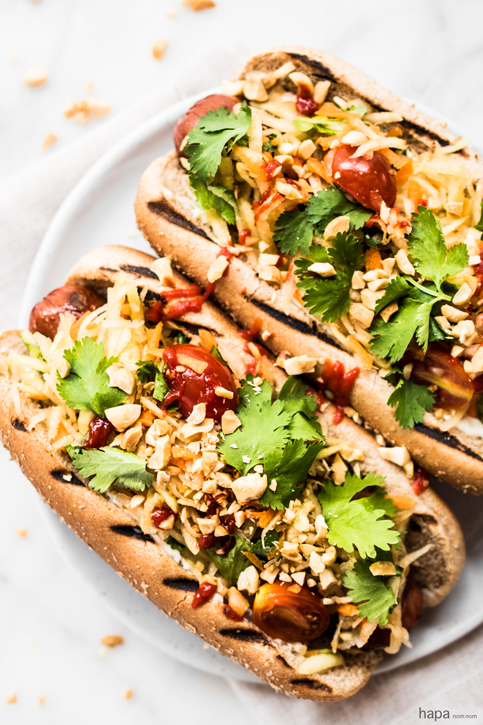 These Thai Style Hot Dogs are a fantastic twist on an American classic - topped with a cool papaya salad, crunchy peanuts, and spicy Sriracha.