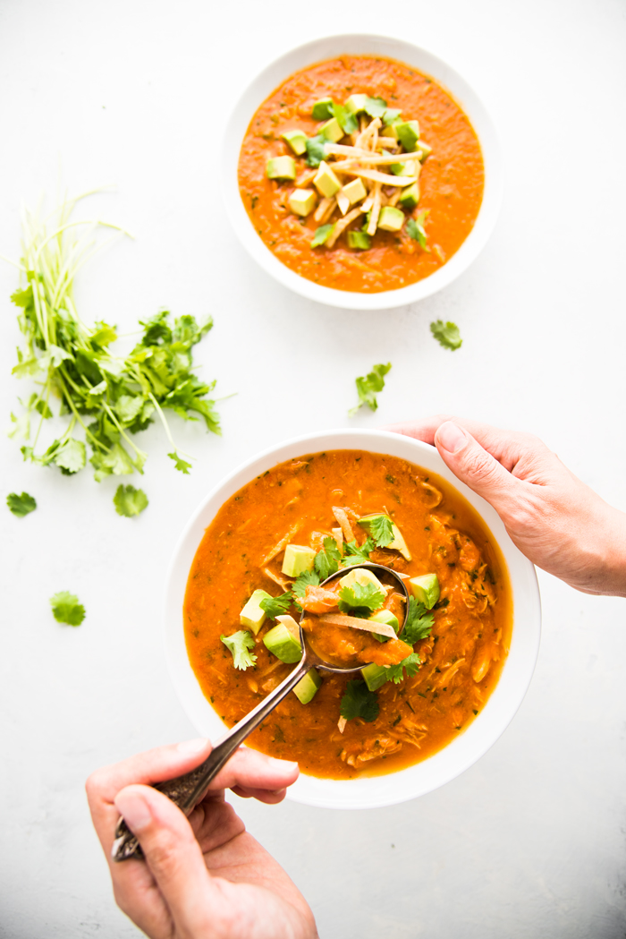 Chicken Tortilla Soup made with fresh tomatoes and topped with avocado ...