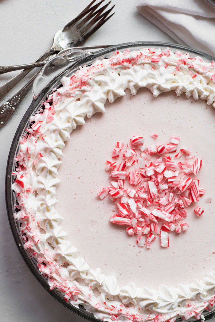 Fun, festive, and SO easy to make! This Candy Cane Ice Cream Pie is a dessert that everyone will love and it's totally customizable!